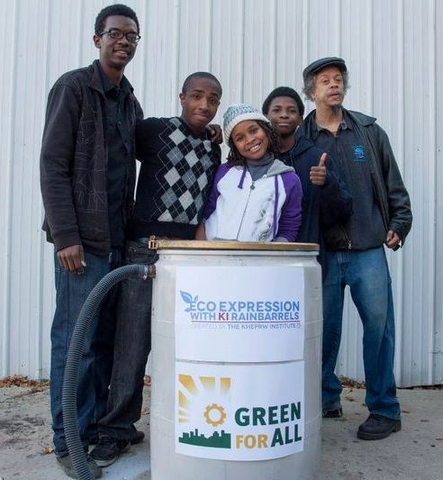 Mat, Rasul, Asli, William, and Imhotep show off an Express Yourself Rainbarrel