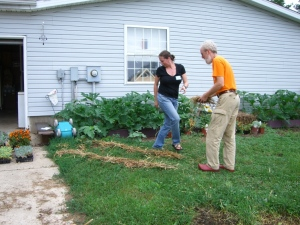 Peter Bane with co-teacher Rhonda Baird laying out a garden path during 2007 permaculture class