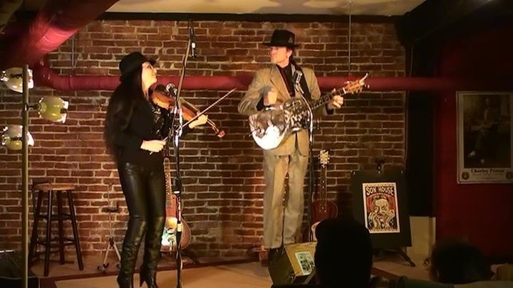 JJ plays a resonator slide guitar in the style used by Delta bluesmen of the 1930s. Irina's violin accompaniment is haunting.
