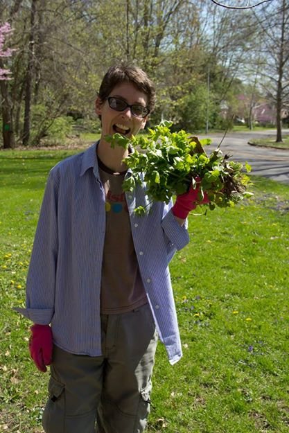 Clowning with invasive garlic mustard. My job at the cleanup was to pull it.