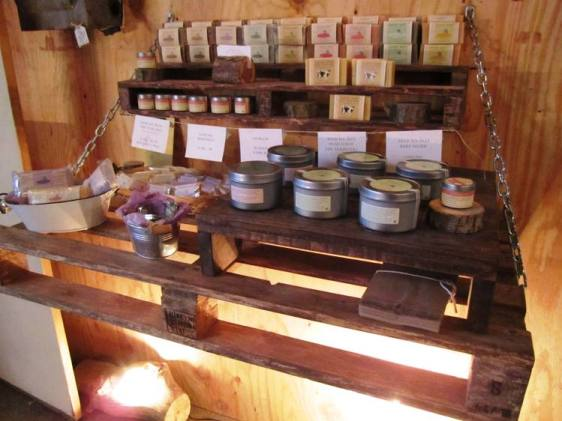 Sculptor Cheryl Lorance makes bathsalts, body butters, and soaps (local Traders Point Creamery milk is a key ingredient!) Displayed here on upcycled pallets.