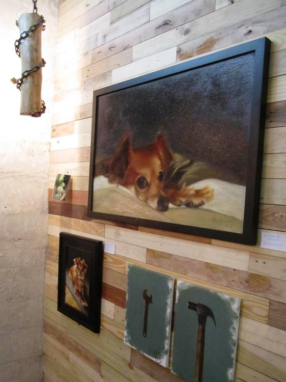Some of Rita Spalding's work displayed on reclaimed wood wall