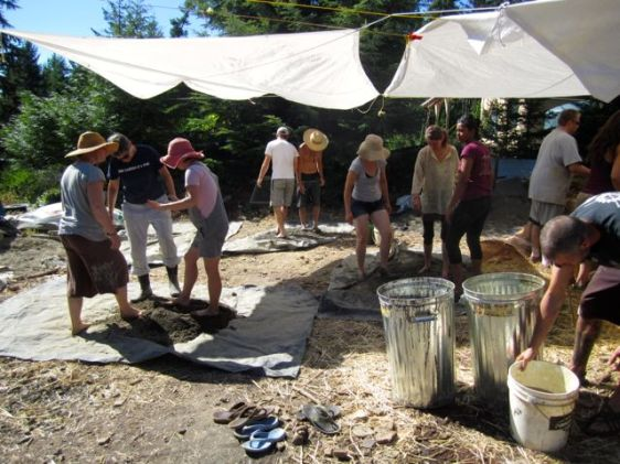 Some of our group making cob, a mix of clay, sand, straw, and water.