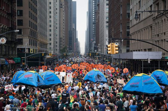 Communities displaced by climate change marched  in the demonstration. Photo by Christine Irvine.