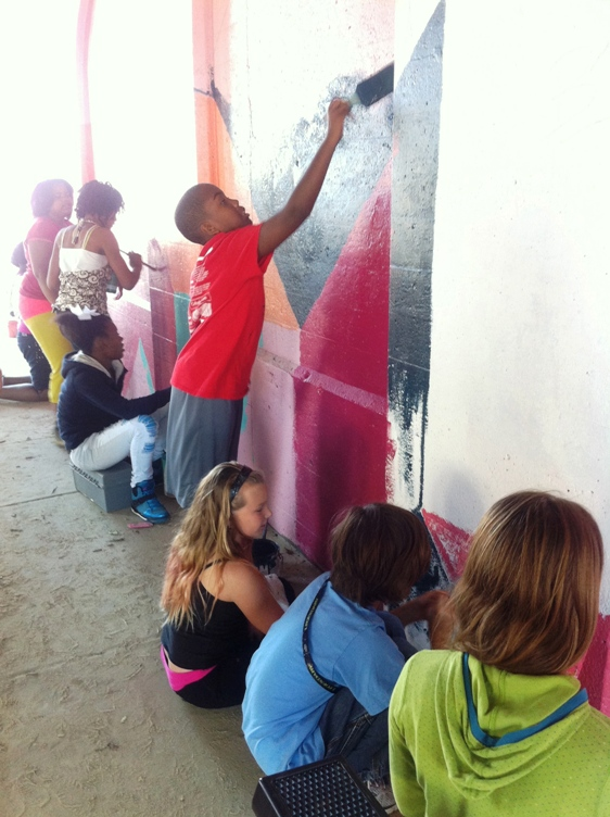 Students from Paramount School of Excellence helped paint this mural.